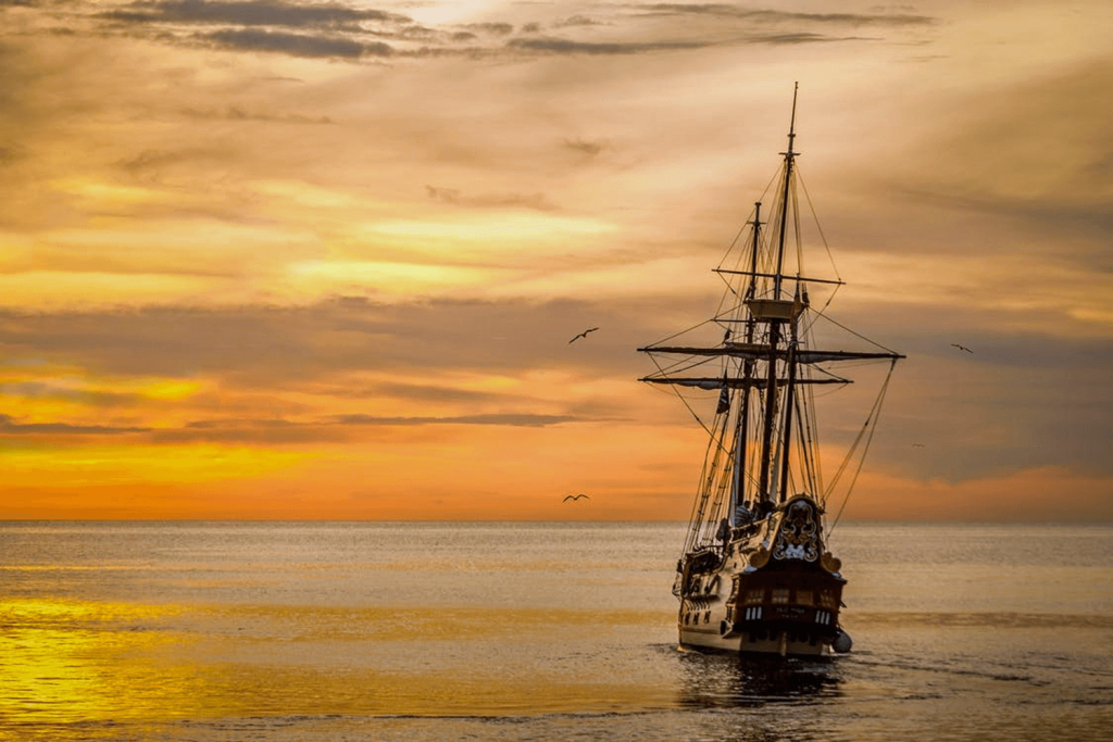 Pirate ship sailing in sunset