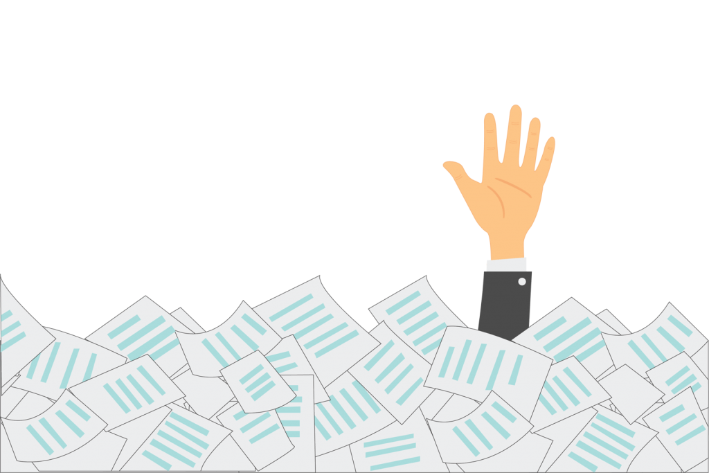 Employee Communications employee drowning in papers