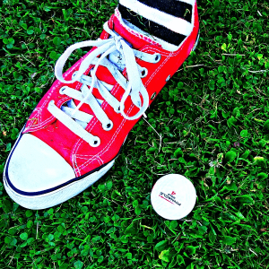 Close up of shoe and golf ball