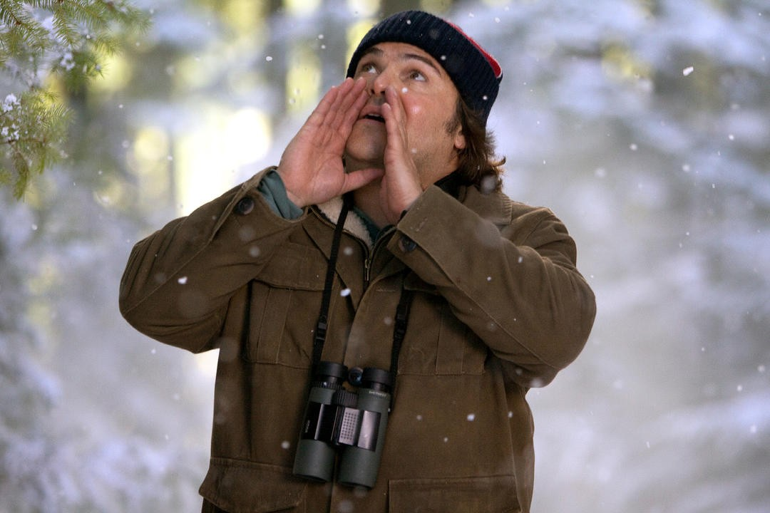 Jack Black calling birds in the snow in the Big Year film