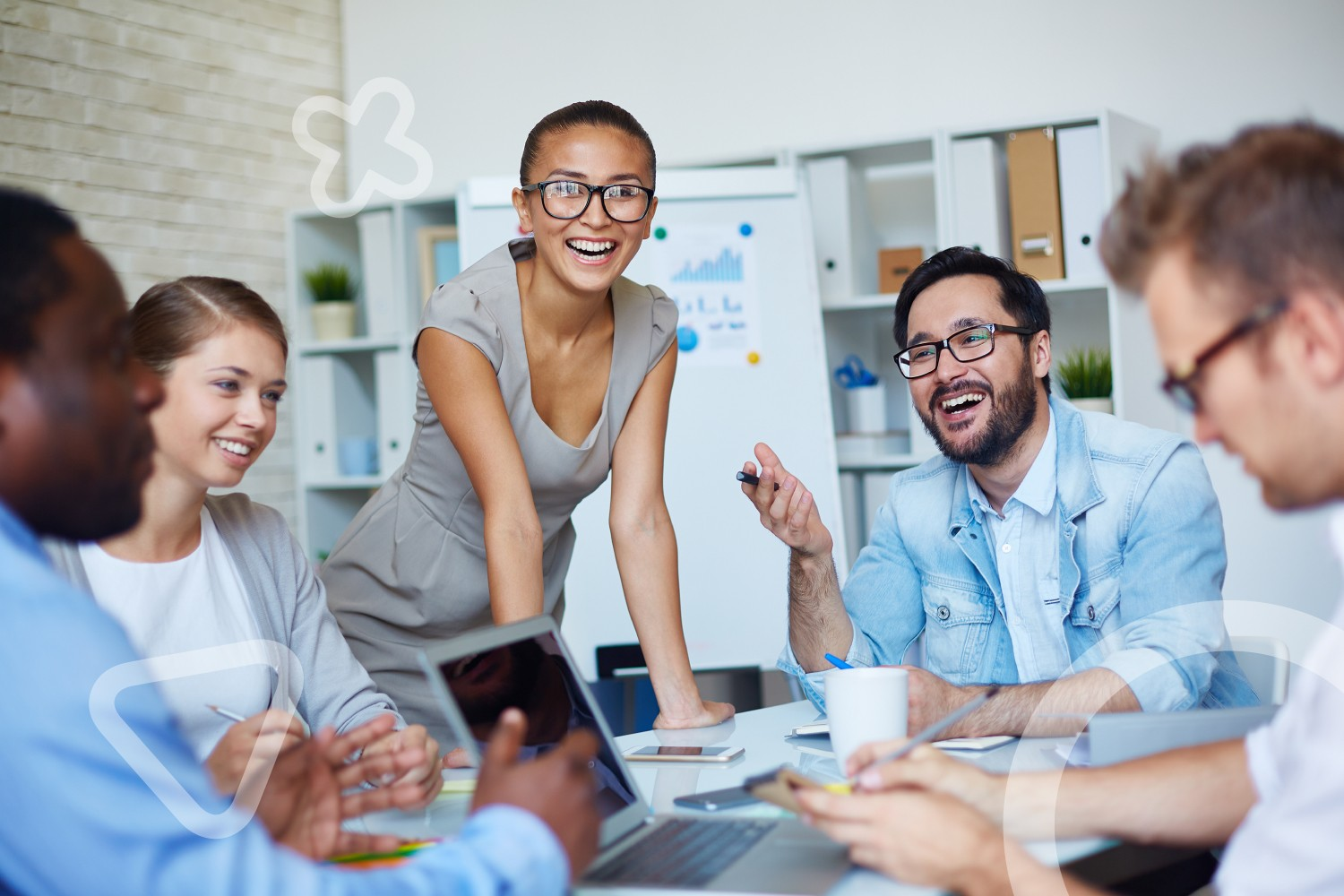 happy engaged employees in meeting at conference table